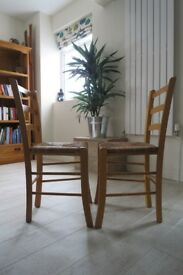pair of Wooden chairs Braided seats