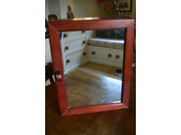 Dark wood bathroom cabinet with two mirrors