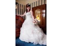 Stunning white wedding dress, strapless. Fit size 10-16, seen in perfect wedding magazine