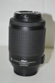 Nikkoe DX-VR 55-200mm f.4/5.6G ED mint as new with front and back nikon covers