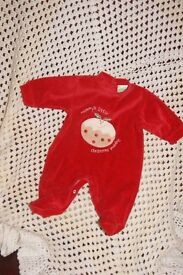 christmas red velour feel sleepsuit newborn size with applique.