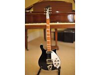 Rickenbacker 620 in Jetglo ( Black ) . 2010 guitar fitted with the super M5 Mastery bridge