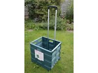 COLLAPSIBLE CRATE / TROLLEY WITH WHEELS.