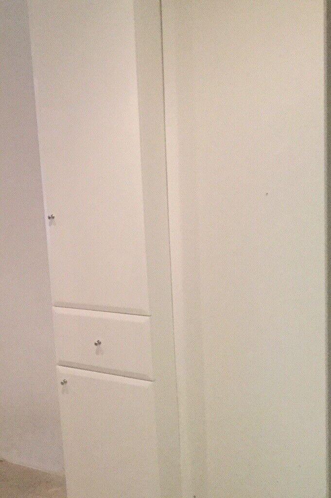 White gloss tall bathroom storage unit.ex display.