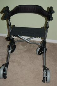ROMA 4 WHEEL MOBILITY WALKER WITH BRAKES AND SEAT.