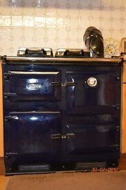 Rayburn oil cooker and heats water