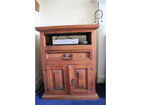 solid pine tv unit with shelf has some age