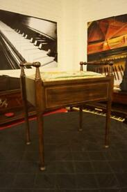 Antique piano stool with music storage
