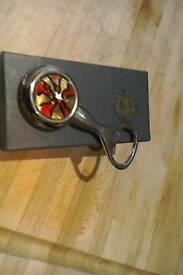 House of marbles bottle opener