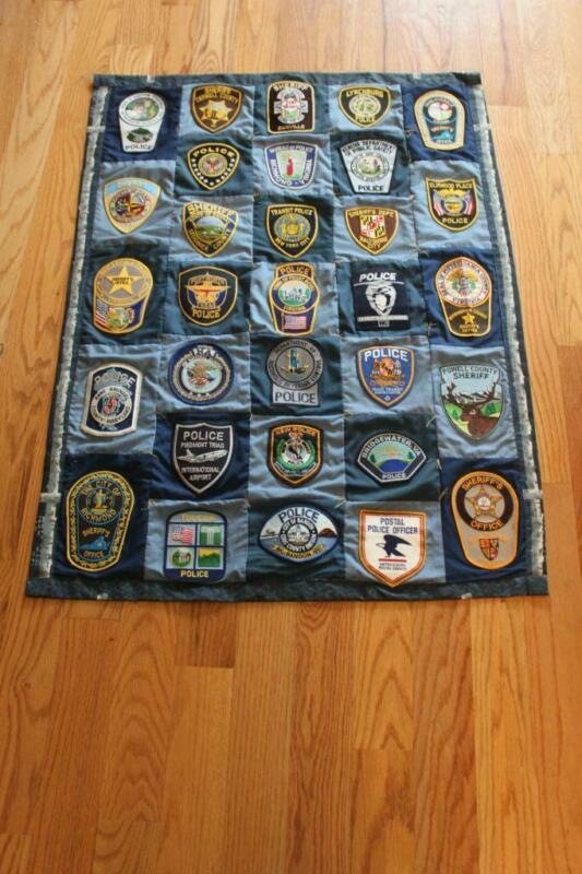 31 Vintage Police Sheriff and Transit  Patches Sewn into Quilt Wall Hanging