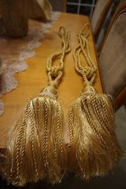 Two Yellow/Gold Tiebacks With Fringe