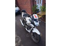 Solid Honda CBF125. Very fuel efficient. Reliable. Excellent commuter/learner bike