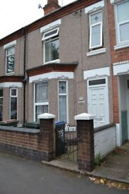 A spacious double bedroom available now in a shared accommodation