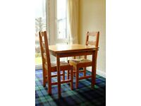 Small, extendable pine dining table and 2 chairs