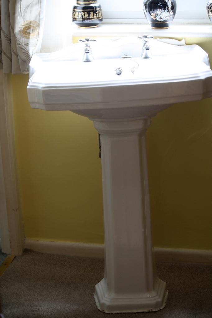Traditional pedestal basin and taps