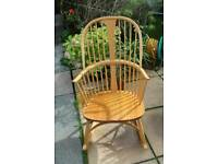Ercol mid-century chairmakers rocking chair in Light finish with cushion