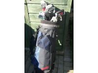 As New Golf bag with clubs , covers , balls etc
