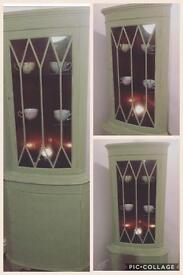 Upcycled green corner cabinet