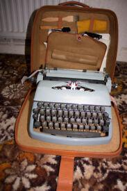 A Rheinmetall Supermetall Portable Typewriter