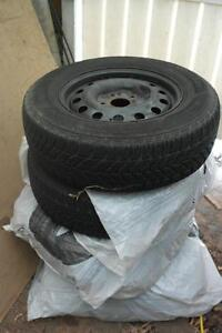 FOUR SNOW TIRES ON RIMS 235 65 16 APROX 2 YRS OLD