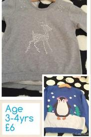 2x girls Christmas jumpers 3-4y