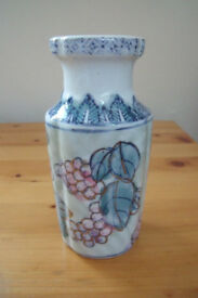 Small ceramic iridescent blue, green, pink, gilded berry and leaf design vase. Excellent condition.