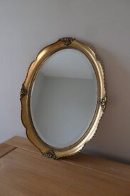 Oval, gilt framed, bevelled mirror by A.W.Morris, 36cm wide x 46cm high