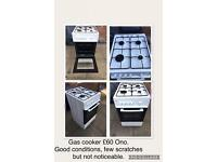 Gas cooker, black leather sofa & round glass table and 3 chairs(not 4)