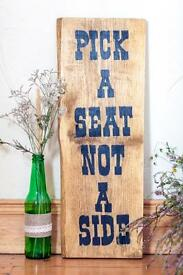 'Pick A Seat Not A Side' Sign