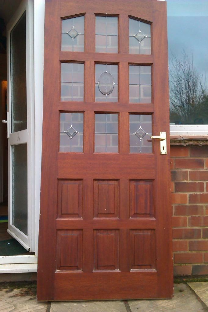 Solid wooden front door with glass panels in sheffield for Entry door glass options