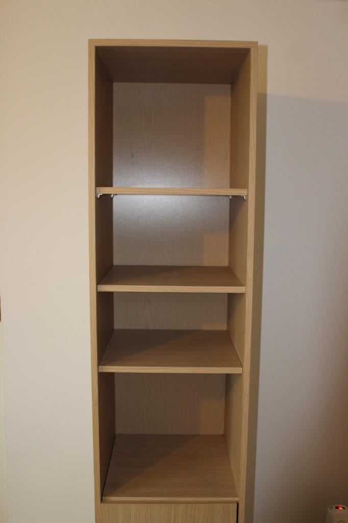 Single Revolving Storage Unit Including A Mirror