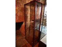 Tall glass fronted cabinet
