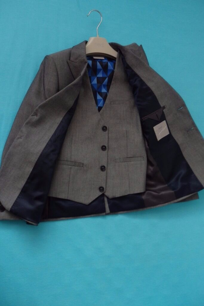 Next Boys Grey 3 pieces Suitin Whitechapel, LondonGumtree - NEXT Signature grey suit Jacket, size 9 years (small fitting) NEXT Signature grey suit Trousers, size 9 years NEXT Signature grey Waistcoat, size 8 years All in a great condition as new used only once at the Holy Communion From pets and smoke free...