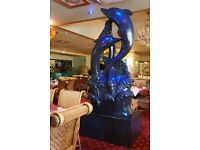 BEAUTIFUL GRANITE STATUE OF 3 DOLPHINS SPLASHING FROM THE SEA FANTASTIC IN RESTAURANT.