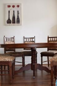 Round 5'6 dining table with 8 chairs