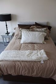 Double bed with mattress and frame