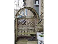 Arched garden arbour/bench.