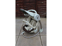 Mamas and Papas baby swing with lights