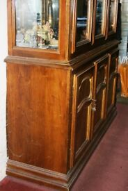 Large wood and glass display cabinet on cupboard base.