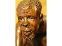 African Tribesman carving