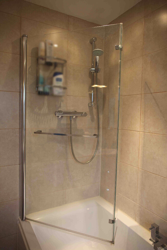 White L shaped bath taps and matching glass shower screen. | in ...