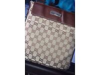 **Gucci pouch + free diesel travel bag (Used)**