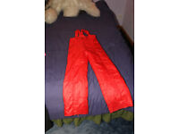 Child's red salopettes, size 152