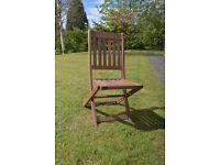 Set of 4 folding wooden garden chairs