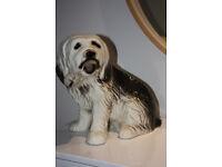 Ceramic dog statue, 45cm long, 33cm high