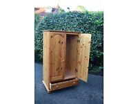 Nursey room wardrobe. A sturdy pine double wardrobe with integral baseline storage draw.