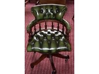 Green leather captains chair.