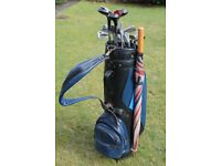 Set of Ladies Golf Clubs - 9 irons, 3 woods & putter, plus golf bag & brolly