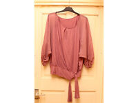 Pink blouse with puffy sleeves