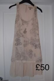 Dresses unworn or worn once. Excellent condition